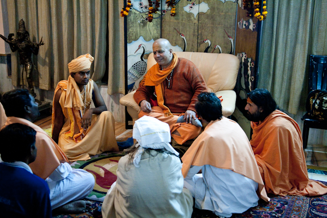 Guru with followers at Ashram